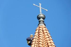 Arnoldas Sirvydis ant Šilutės evangelikų liuteronų bažnyčios bokšto.